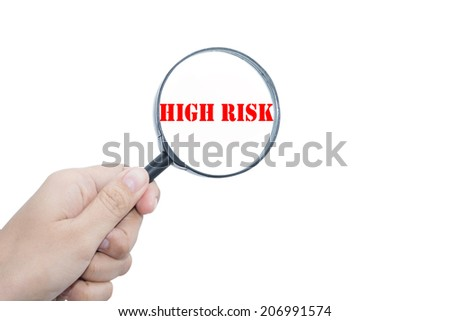 Hand Showing  HIGH RISK   Magnifying Glass  - stock photo