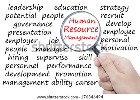 Hand Showing human resource management Word Through Magnifying Glass   - stock photo