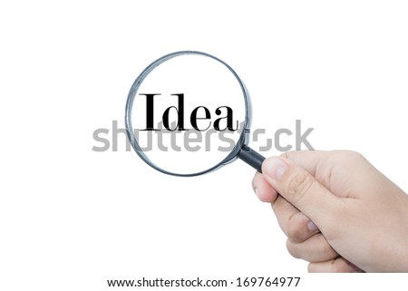 Hand Showing Idea Word Through Magnifying Glass