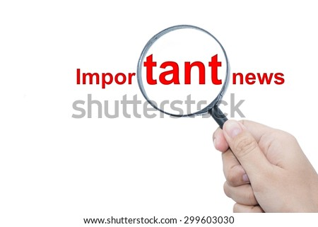 Hand Showing Important news Word Through Magnifying Glass