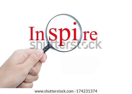 Hand Showing Inspire is Everything Word Through Magnifying Glass