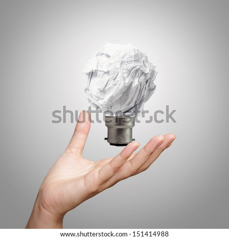 hand showing light bulb crumpled paper as creative concept - stock photo
