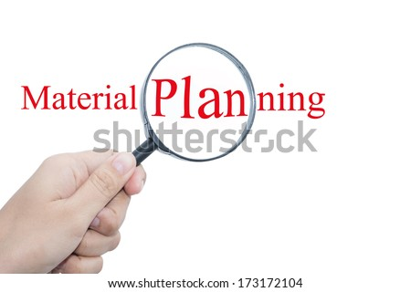 Hand Showing Material planning Word Through Magnifying Glass  - stock photo