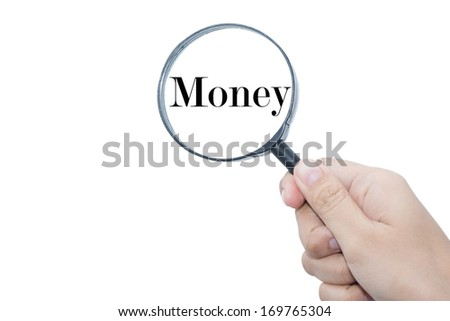 Hand Showing Money Word Through Magnifying Glass - stock photo