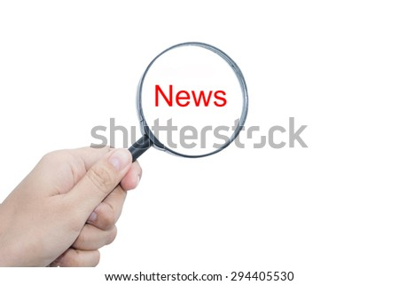 Hand Showing  News Word Through Magnifying Glass  - stock photo