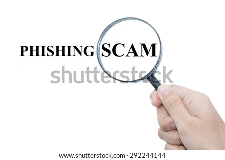Hand Showing PHISHING SCAM Word Through Magnifying Glass  - stock photo