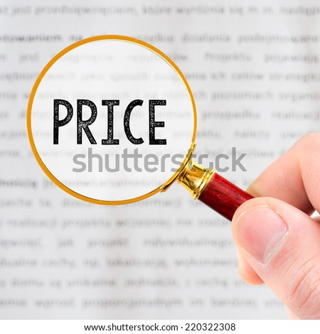 Hand Showing Price Word Through Magnifying Glass - stock photo