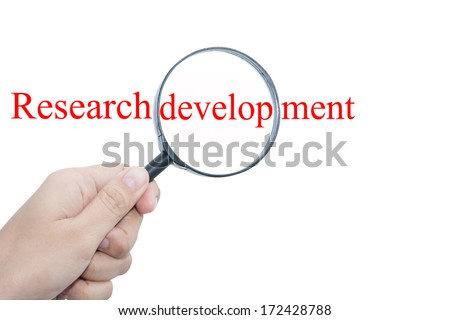 Hand Showing Research development Word Through Magnifying Glass  - stock photo