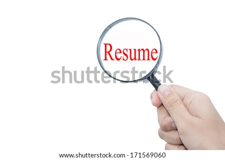 Hand Showing Resume Word Through Magnifying Glass - stock photo