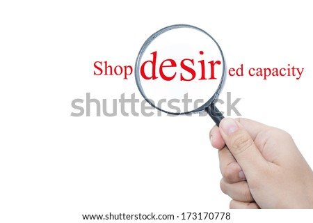 Hand Showing Shop desired capacity Word Through Magnifying Glass