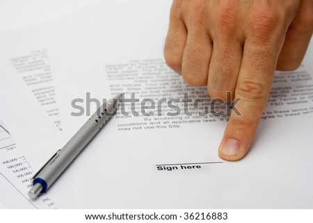Hand showing signature place on contract - stock photo