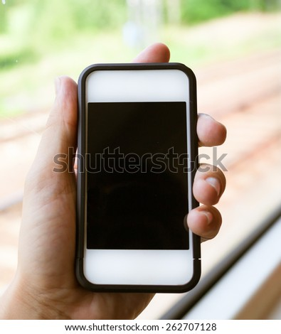 Hand showing smartphone  - stock photo
