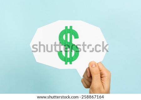 Hand showing speech bubble with green money dollar symbol, on blue background.