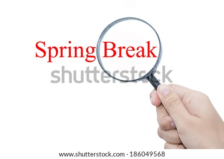 Hand Showing Spring Break Word Through Magnifying Glass  - stock photo