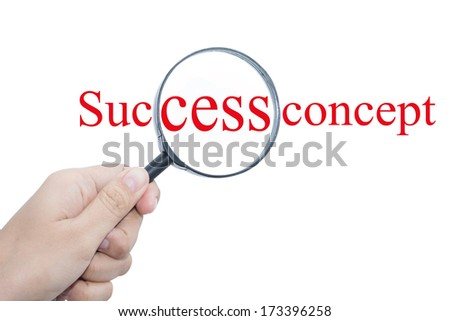 Hand Showing Success concept Word Through Magnifying Glass   - stock photo