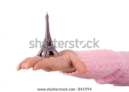 hand showing the model of the tour eiffel on the white background with copycpase