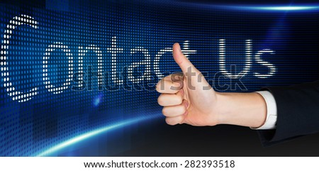 Hand showing thumbs up against contact us on digital screen