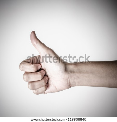 hand showing thumbs up sign - stock photo