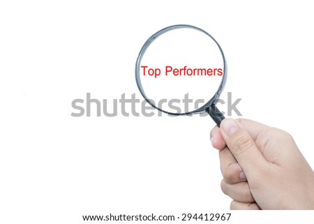 Hand Showing Top Performers Word Through Magnifying Glass