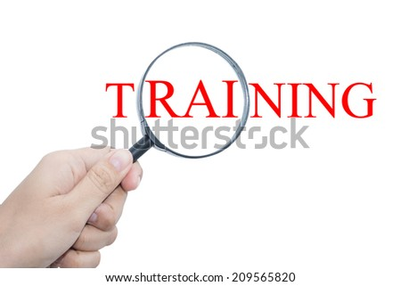 Hand Showing TRAINING Word Through Magnifying Glass  - stock photo