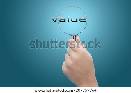 Hand Showing value Word Through Magnifying Glass
