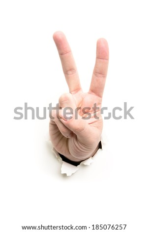 hand showing victory through the paper hole isolated on white background
