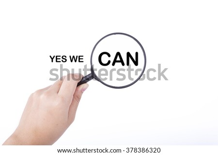 Hand showing YES WE CAN word through magnifying glass. Isolated white, financial and business concept - stock photo