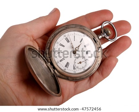 Hand shows antique pocket watch, isolated on white - stock photo
