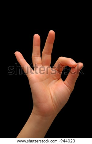 Hand signal for OK, isolated with a black background