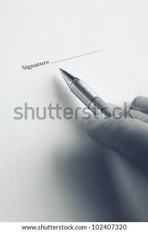hand signature here - stock photo
