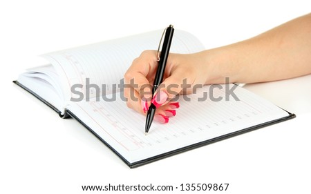 Hand signing in notebook, isolated on white