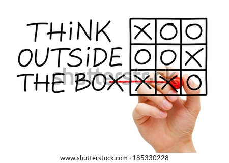 Hand sketching Think Outside The Box tic-tac-toe game concept with marker on transparent wipe board. - stock photo