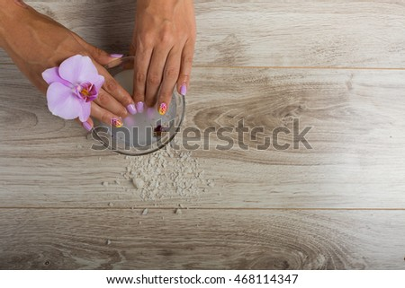 Hand spa essential on wooden background. Beauty concept