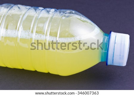 Hand-squeezed lemon and orange juice in a bottle