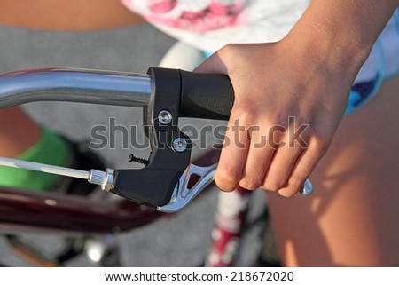 Hand squeezing bicycle brake lever - stock photo