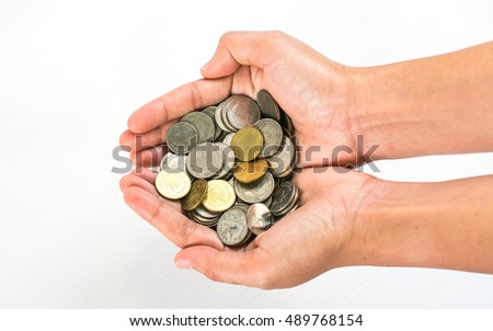 Hand stacking coins on  white background