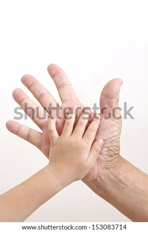 Hand superimposed father and child - stock photo