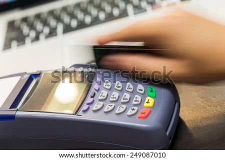 Hand Swiping Credit Card In Store - stock photo