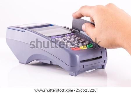 Hand Swiping Credit Card On Credit Card Machine - stock photo