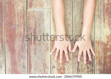 Hand symbol on a wooden floor.