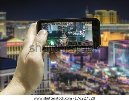 Hand takes a picture in Las Vegas, USA - stock photo