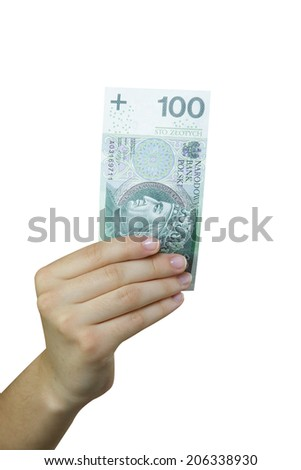 Hand taking a banknote of 100 polish zloty - stock photo