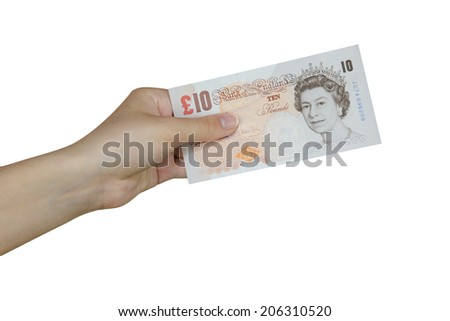 Hand taking a banknote of 10 pounds - stock photo