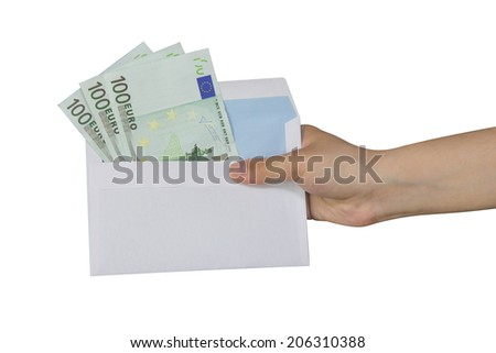 Hand taking an envelope with euros inside - stock photo