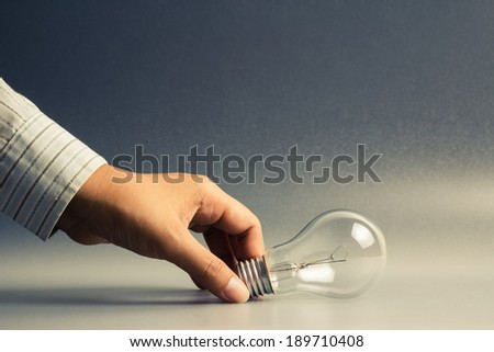 Hand taking light bulb as getting idea concept