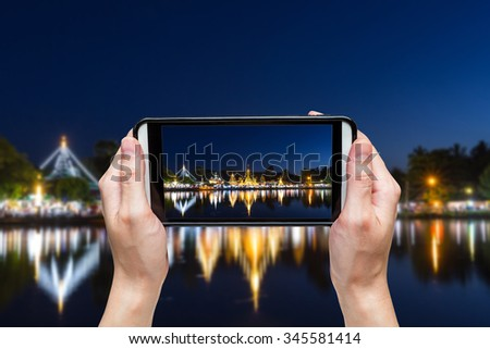 Hand taking photo at Wat Chong Klang and Wat Chong Kham at Mae Hong Son, Northern Thailand - stock photo