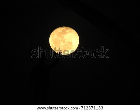 Hand  taking the fullmoon.
