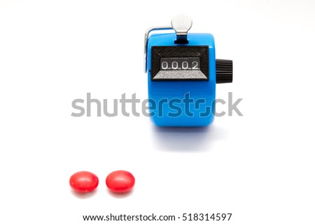 hand tally with 2 red candies