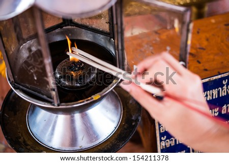 hand temple incense - stock photo