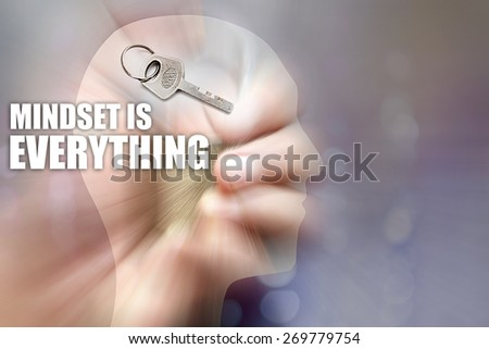 Hand that grasps the padlock, keys and figure the human body with radial blur zoom technique concept of how humans think, plan and act in the face of great challenges. Mindset is everything - stock photo